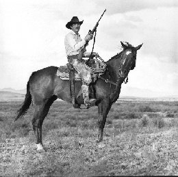 Alfred Gillette Means on Horseback with Rifle
